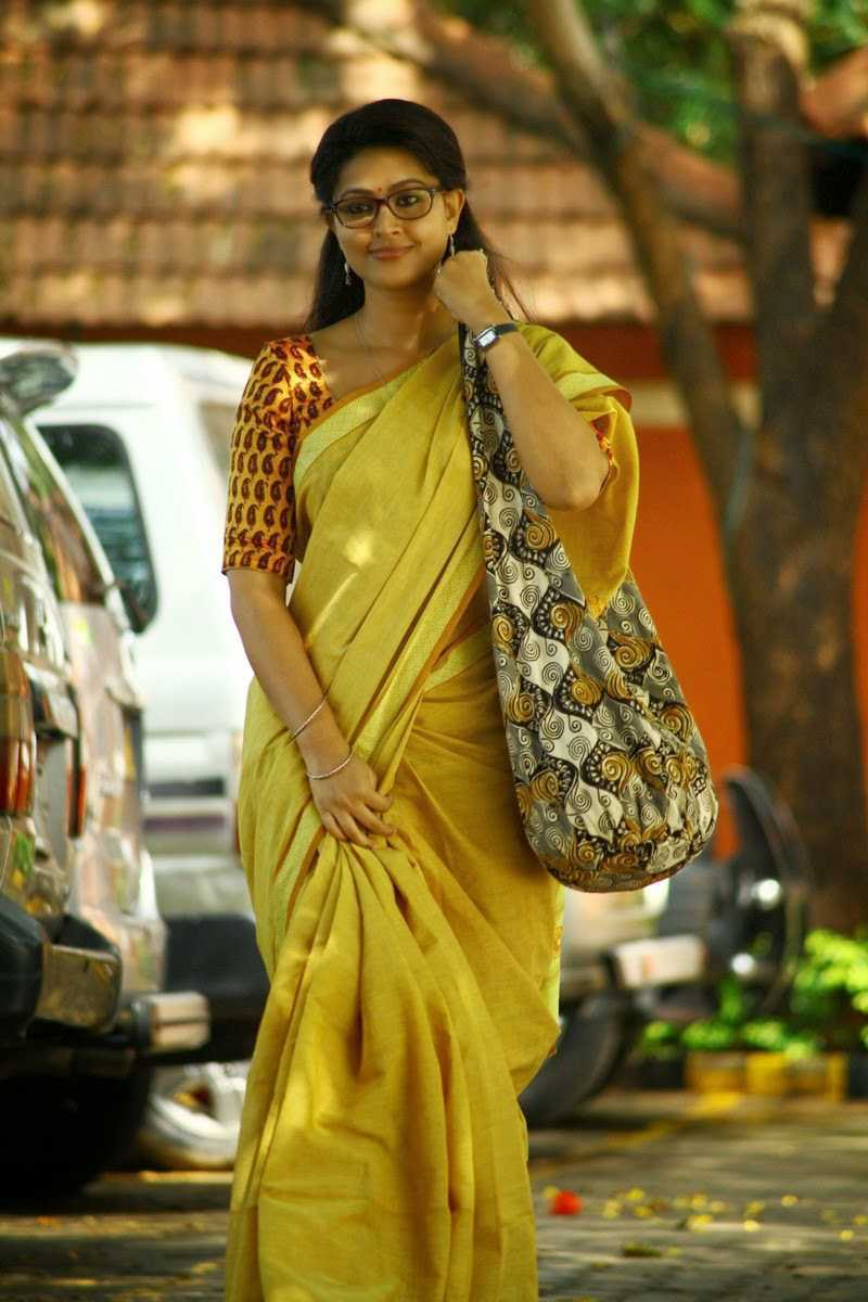 Kollywood Actress Sneha Stills With Glass In Yellow Saree
