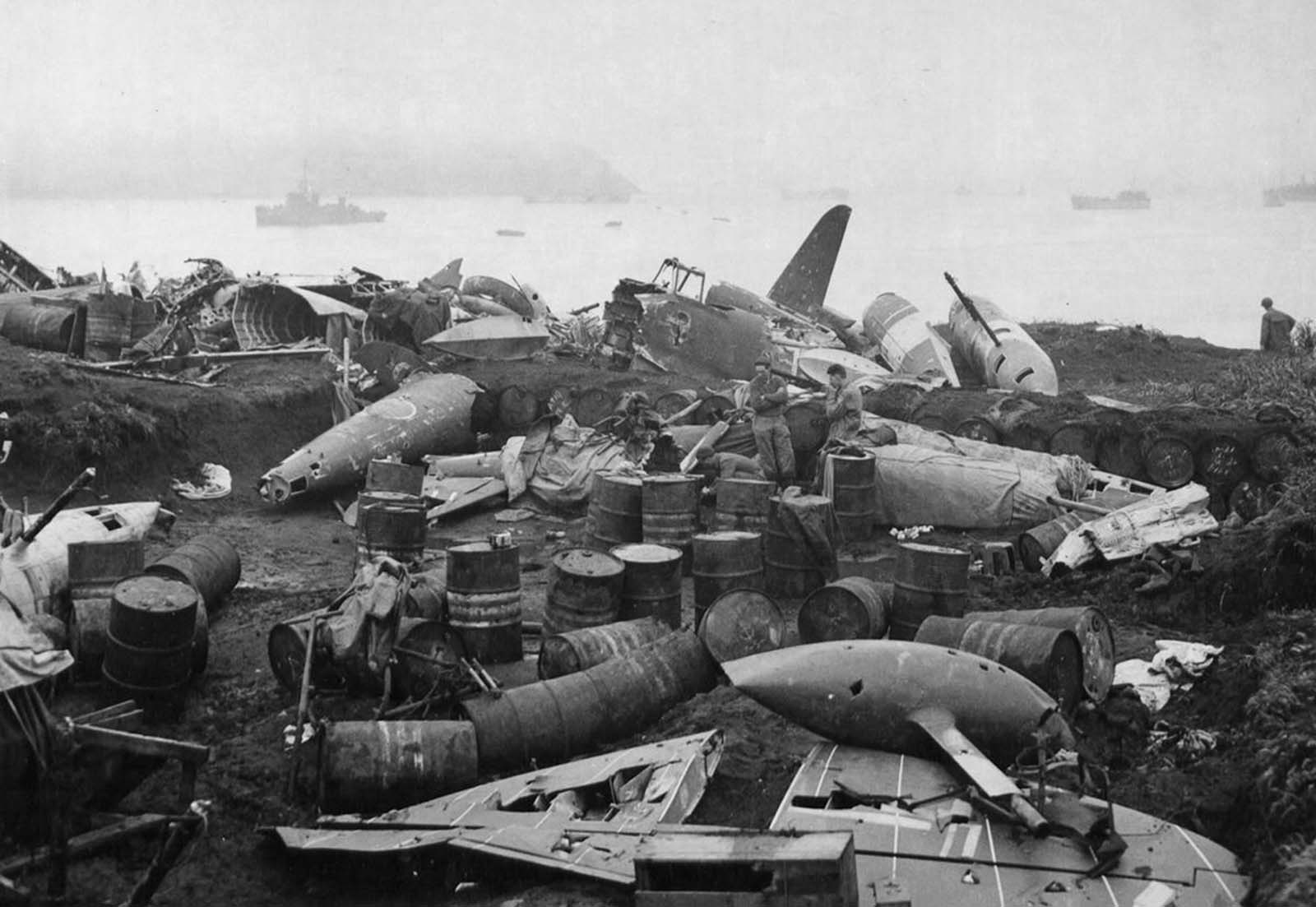 Wrecked Japanese planes, oil and gas drums are a mass of rubble on Kiska, Aleutian Islands, on August 19, 1943, as a result of Allied bombings.