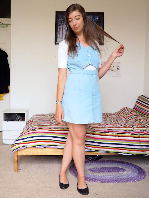 Alice in Wonderland Disneybound outfit of blue denim dress, white top & black ballet flats