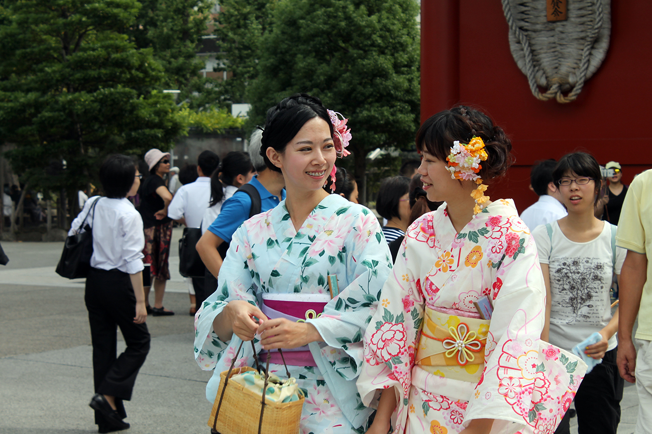 two girls dressed as geishas at sense ji temple, Tokyo