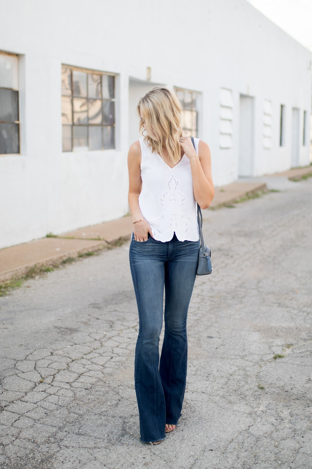 White top with dark wash denim