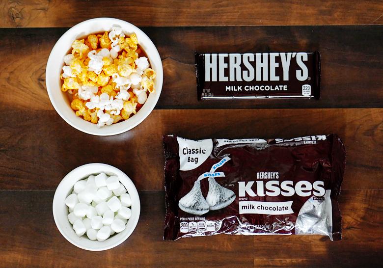 Sweet & salty cheddar popcorn HERSHEY's chocolate bark recipe, this stuff is ADDICTING!
