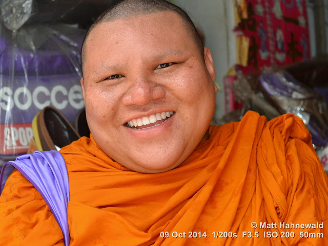 © Matt Hahnewald, Facing the World, people, portrait, street portrait, smiling, Thailand, Buddhism, Buddhist monk, orange robe, shaved head, saffron robe, Theravada Buddhism, bhikkhu, Bangkok, religion, culture, face, eye contact