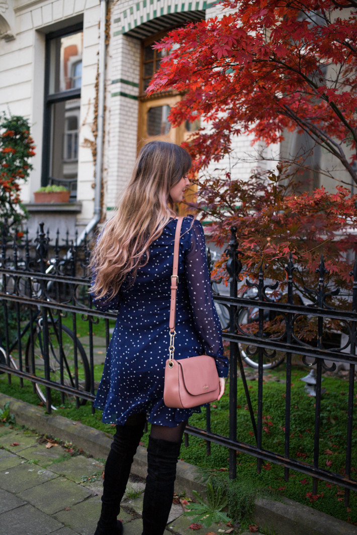 Outfit: star print wrap dress and thigh highs, kate spade bag