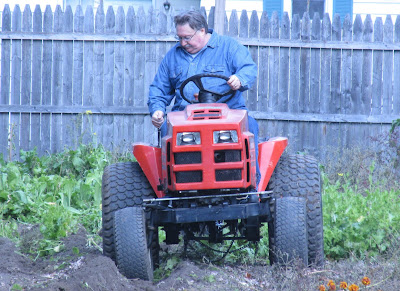 Husband plowing the garden-Vickie's Kitchen and Garden