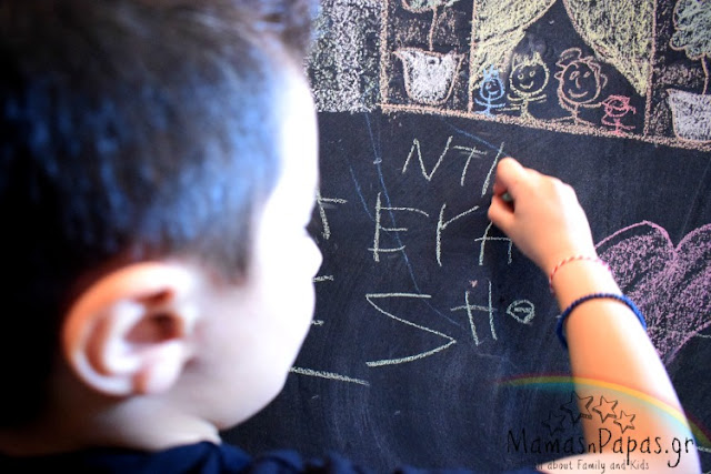 kids drawing on a chalkboard