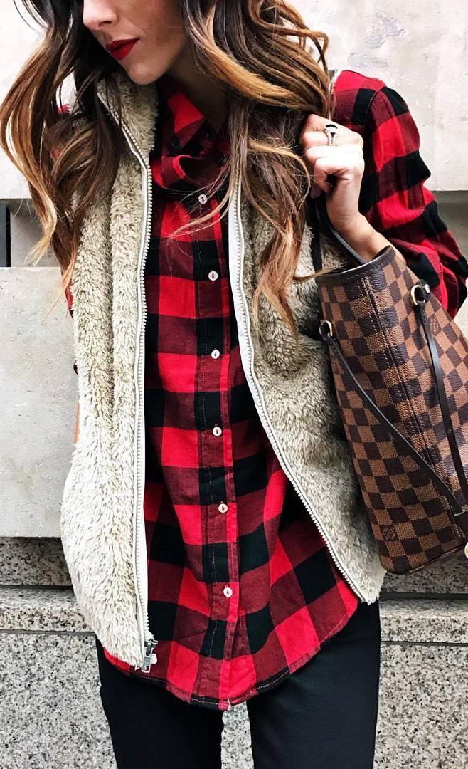 winter outfit idea / plaid shirt + fur vest + bag + black skinnies