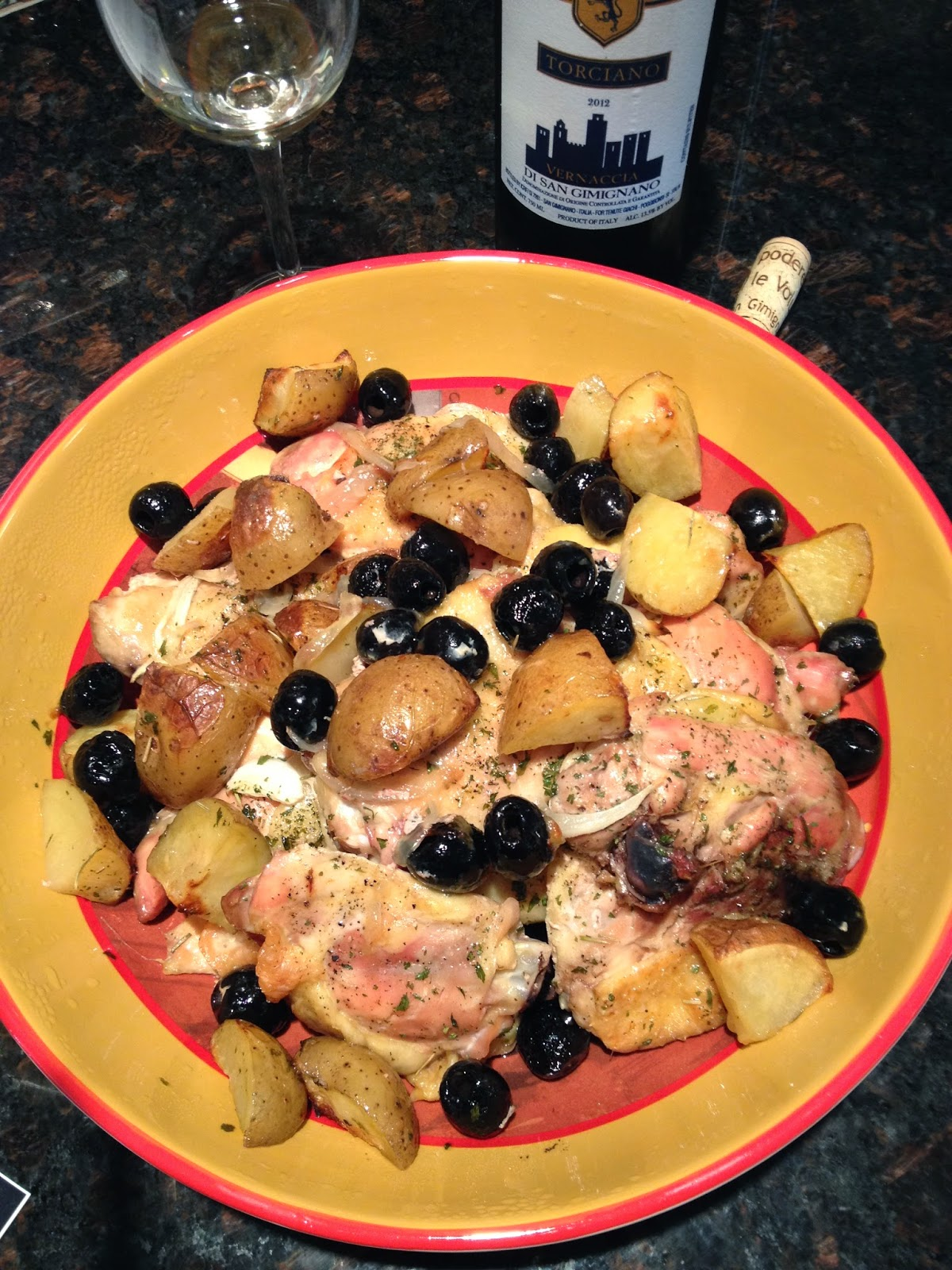 Roasted chicken with potatoes and black olives