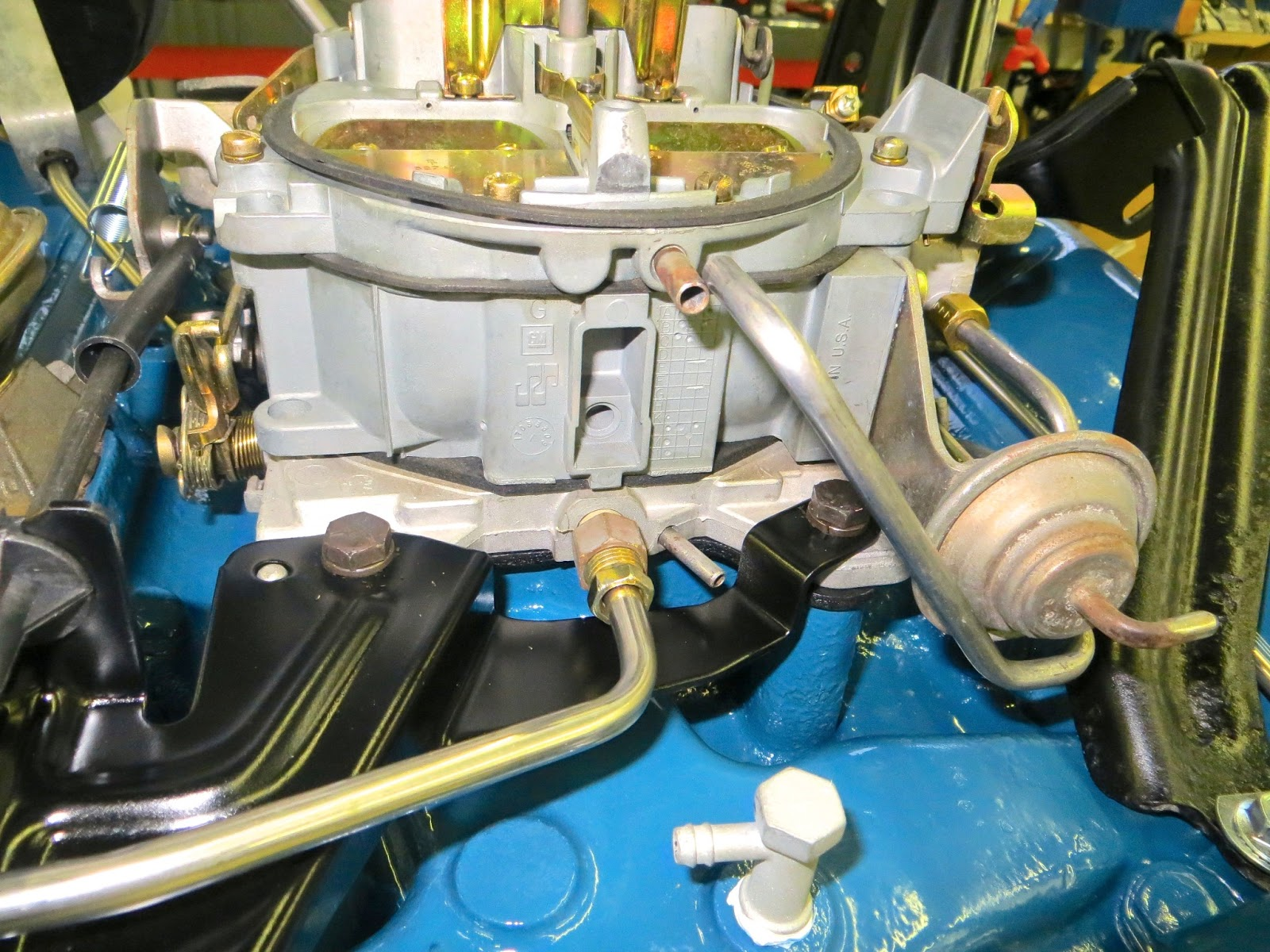 hight resolution of 3 ports at the rear of the carburetor the upper port is the choke heater air inlet the bottom two ports are manifold vacuum for the power brake booster