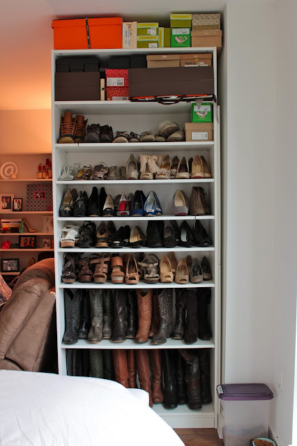 shoe case, book case of shoes, book shelf of shoes, book case with shoes