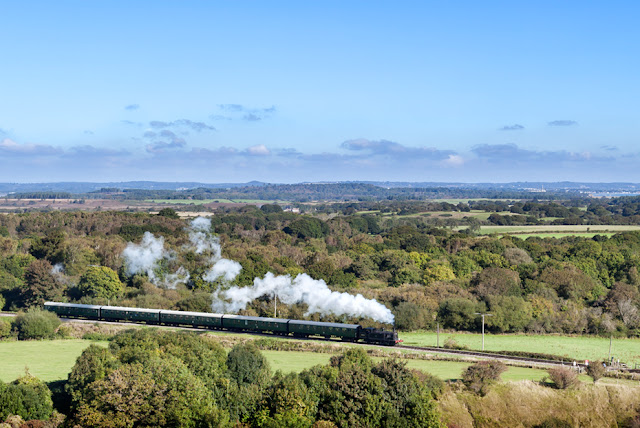 Steam train running through the landscape in the Isle of Purbeck, Dorset