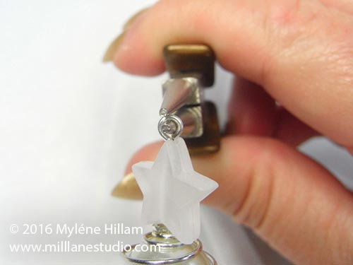 Form a simple loop above the star bead with the round nose pliers.