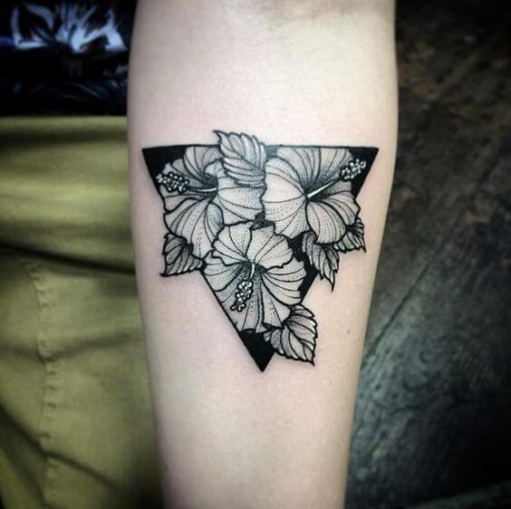 small star tattoo on hand