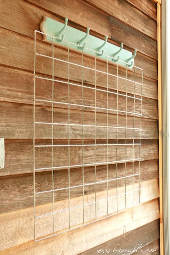 wire-grid-hung-from-metal-hooks-to-create-potting-area