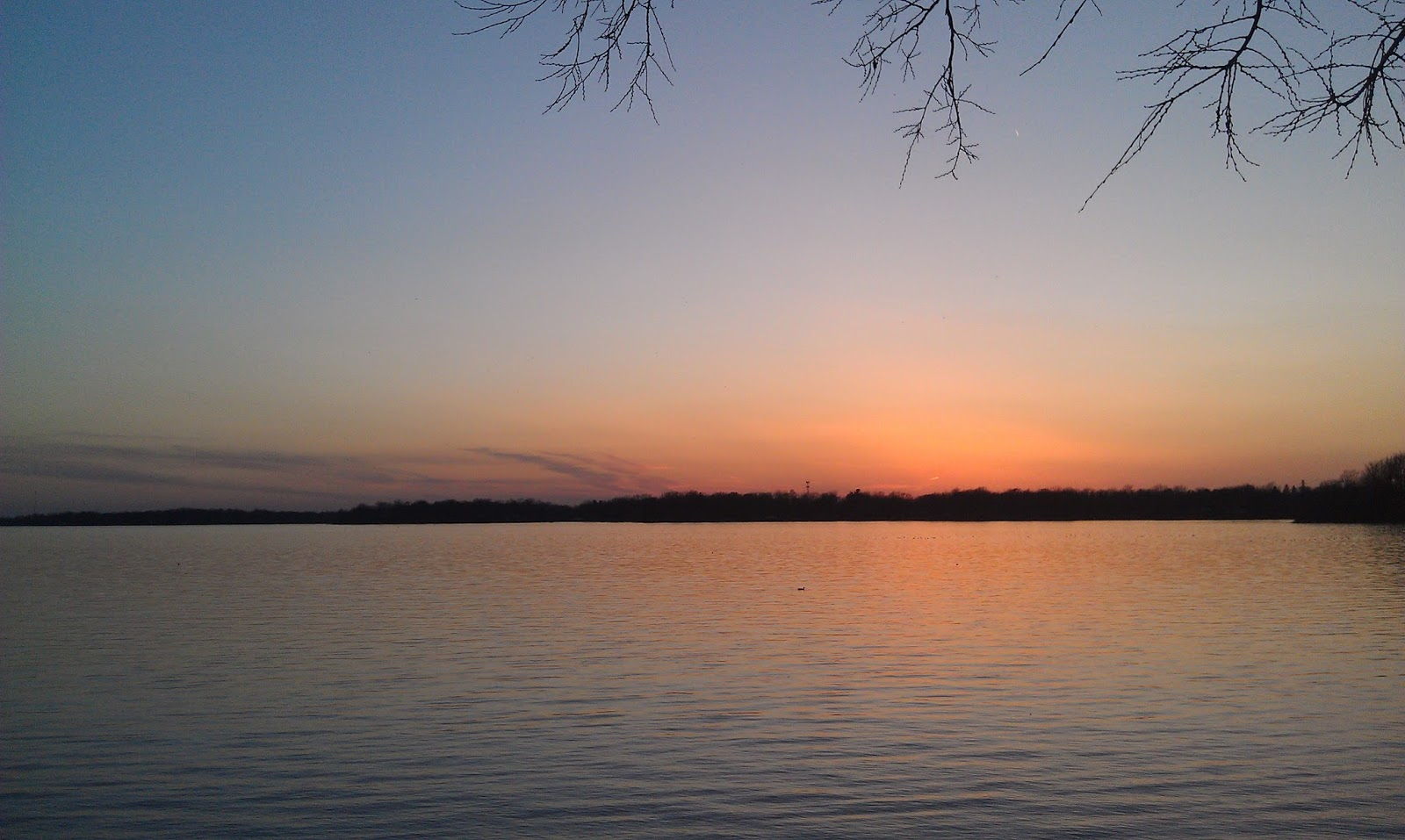 Picture of a sunset over a lake
