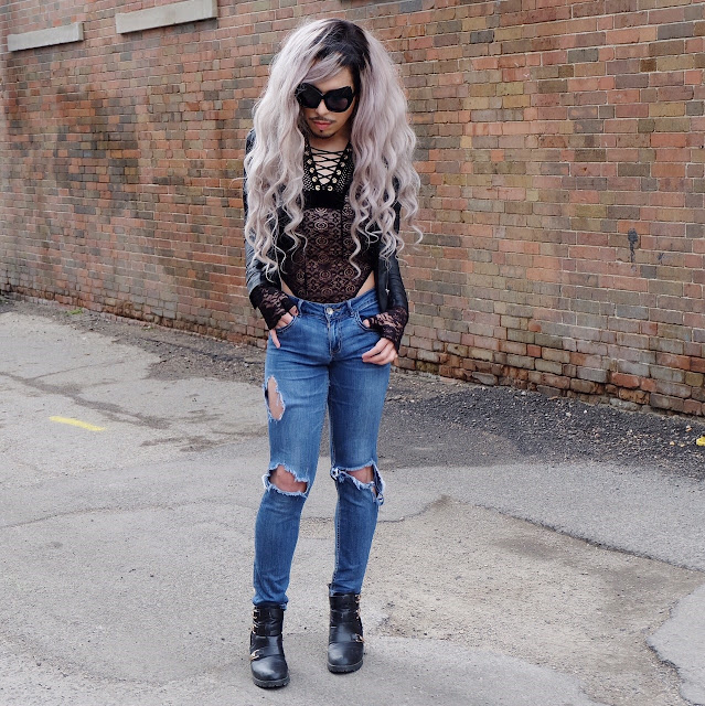 Leather jacket from: @buffalojeans  Lace bodysuit from: @sanssoucistores  Ripped boyfriends from: @democracyclothing  Cat sun glasses from: @zerouv  Buckle boots from: @wantedshoes