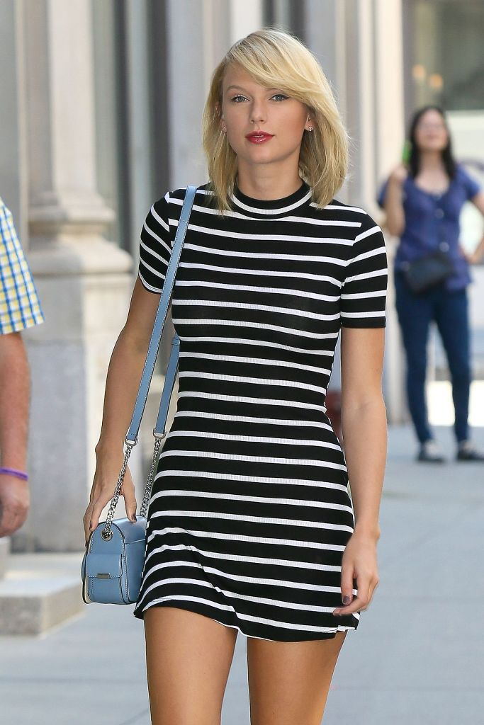 Taylor Swift leggy in mini dress out in New York