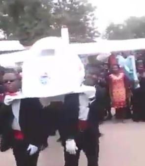 pilot buried aeroplane casket