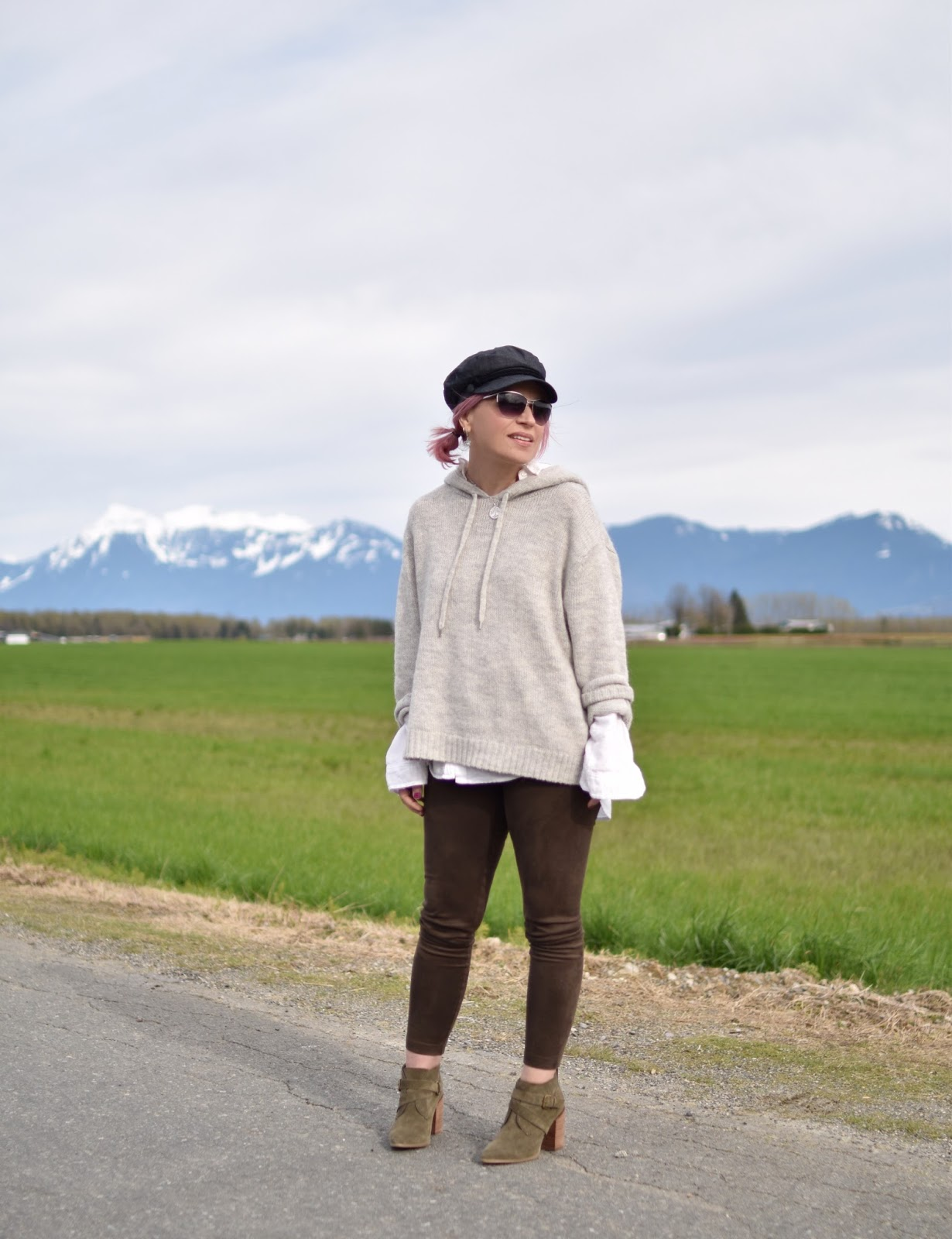 Road tripping:  styling vegan suede leggings with ankle booties, a hoodie sweater, and a baker boy cap