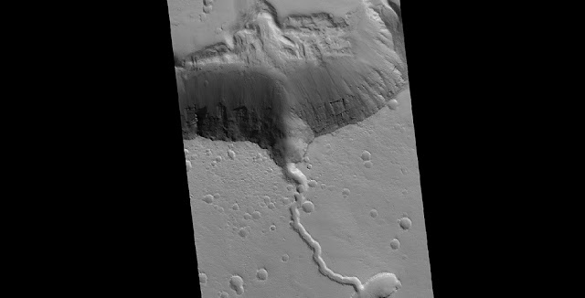 A solidified lava flow over the side of a crater rim of Elysium. Photo Credit: NASA HiRISE image, David Susko, LSU.