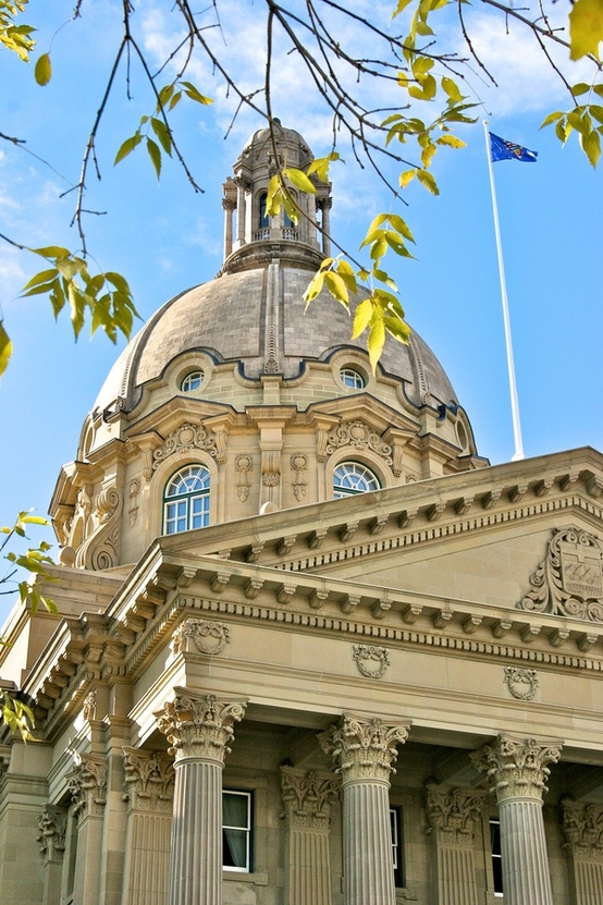 "The Alberta Legislature Building is located in Edmonton, Alberta, and is the meeting place of the Legislative Assembly and the Executive Council. It is known to Edmontonians as ""the Leg"" (pronouced as in ""ledge"" and not ""leg"").  The building is located on a promontory (overlooking the North Saskatchewan River valley to the south) which was once the location of Fort Edmonton, Mark V (1830–1915), a Hudson's Bay Company fur-trading post. It is just up the hill from the archeaological finds at Rossdale Flats to the east, which was long-standing First Nations campsite and earlier location of Fort Edmonton. The legistature's location was selected shortly after Edmonton was confirmed as the provincial capital by the first session of the Legislature in 1906."