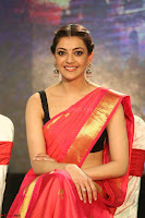 Kajal Aggarwal in Red Saree Sleeveless Black Blouse Choli at Santosham awards 2017 curtain raiser press meet 02.08.2017 085.JPG