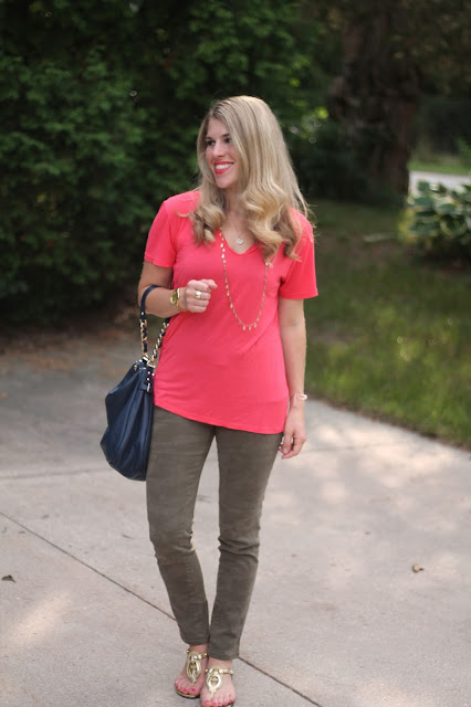 Coral piko top, camo pants, gold sandals, navy Kate Spade bag