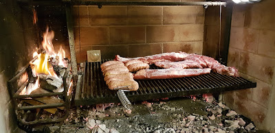 Argentinean asado in parrilla