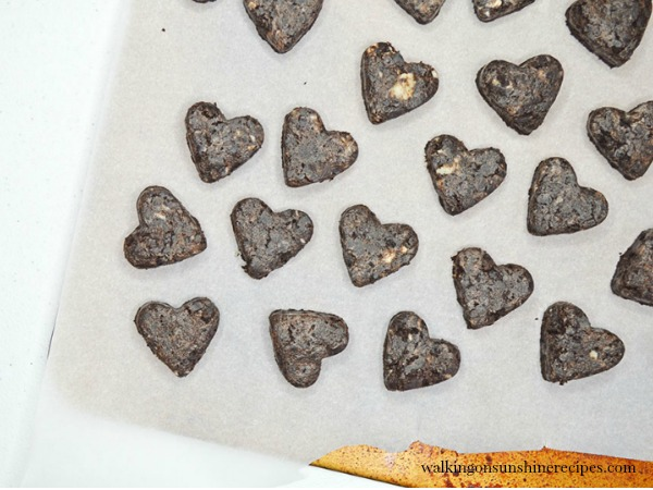 Using your mini heart cookie cutter, cut out cookie shapes for Valentine's Heart Shaped Oreo Truffles from Walking on Sunshine Recipes