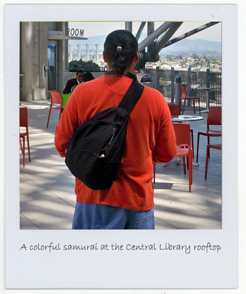 Orlando Barahona dressed as a colorful samurai at the San Diego Central Library on the ninth floor