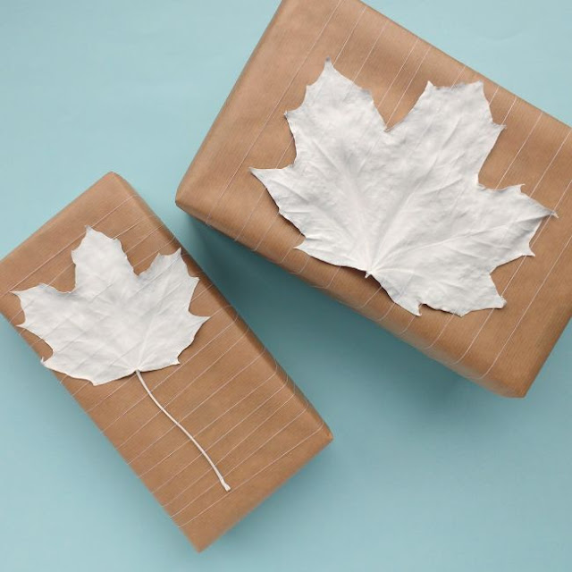 simple parcels decorated with painted leaves