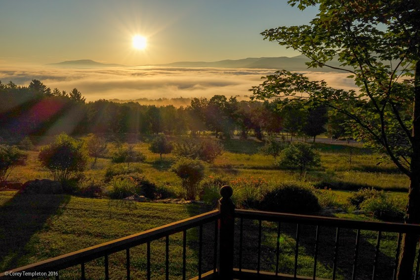 August 2016 photo by Corey Templeton of a sunrise over the clouds and mountains in Stowe, Vermont.