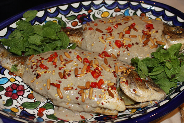 Lebanese baked spicy fish in with tahini sauce