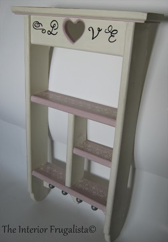 Vintage wooden wall shelf with heart cut out