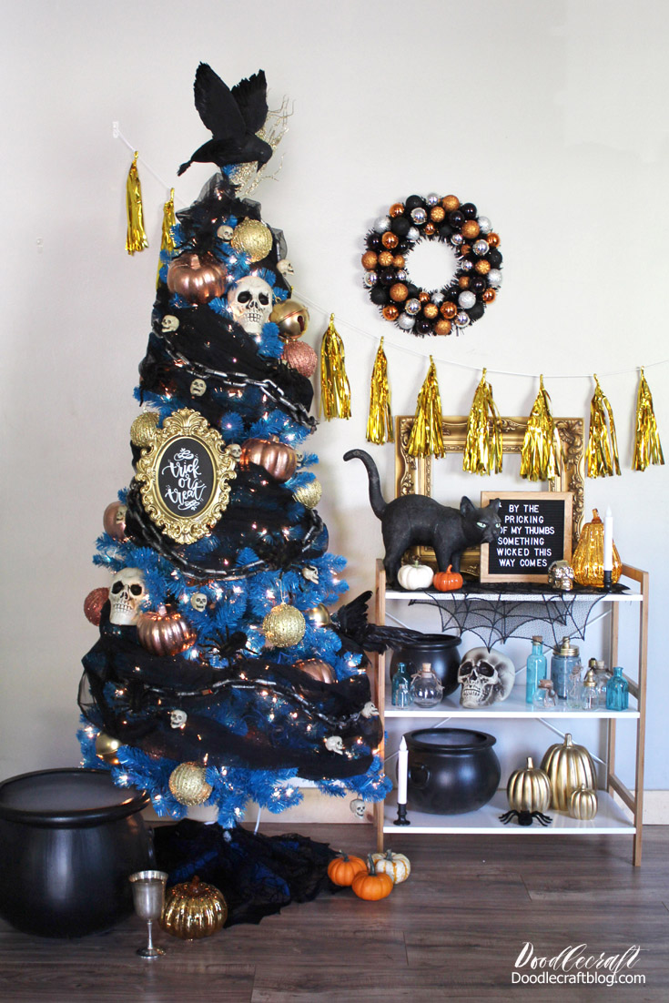Decorate a bright blue slim Christmas holiday tree with Halloween ornaments!