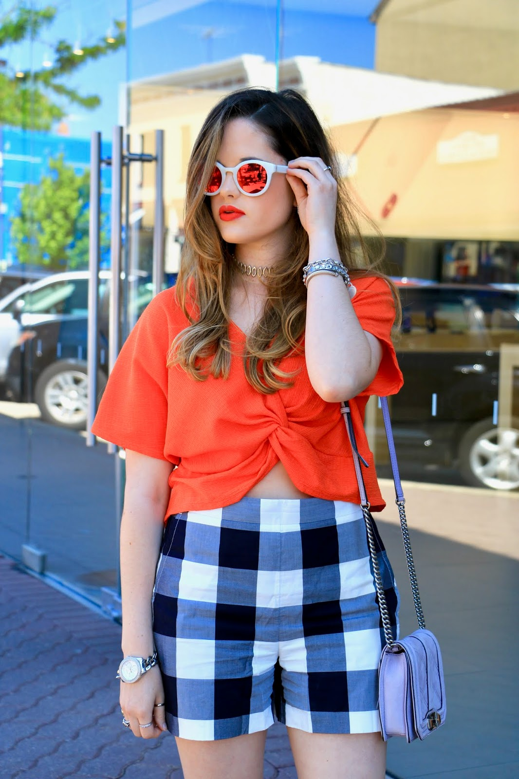 Nyc fashion blogger of Kat's Fashion Fix, Kathleen Harper, wearing Urban Decay orange lipstick