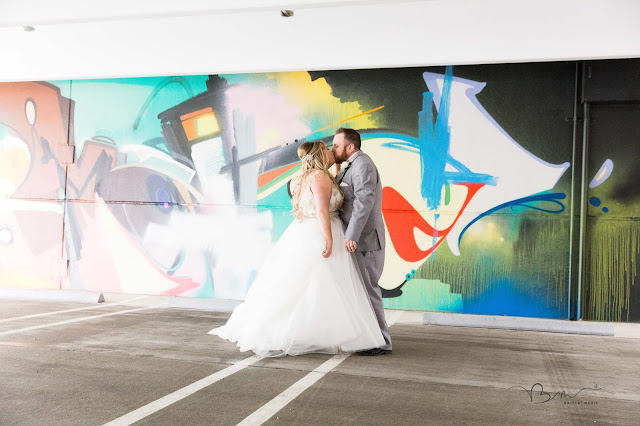 bride and groom dancing on the z belt lot in Detroit by graffiti
