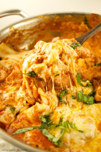 Spoon lifting cheesy one pot chicken lasagne from a dish