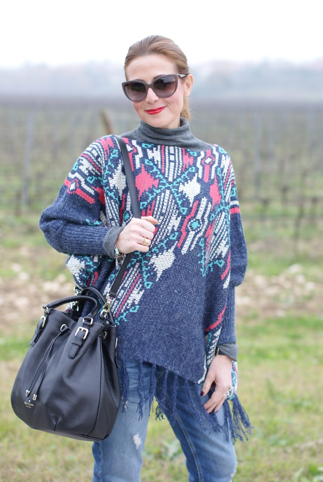 Fringed aztec poncho for a western inspired outfit on Fashion and Cookies fashion blog, fashion blogger style