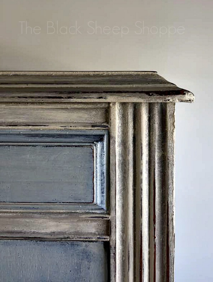 Corner of armoire with distressed finish