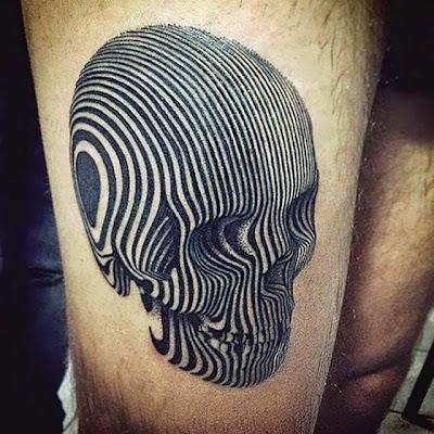 Tatuaje con craneo hecho con lineas.