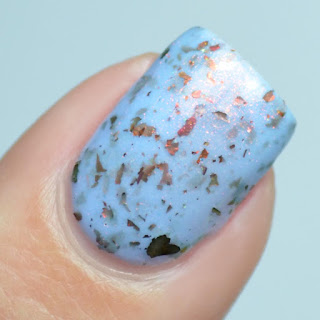 pale blue nail polish with color shifting flake