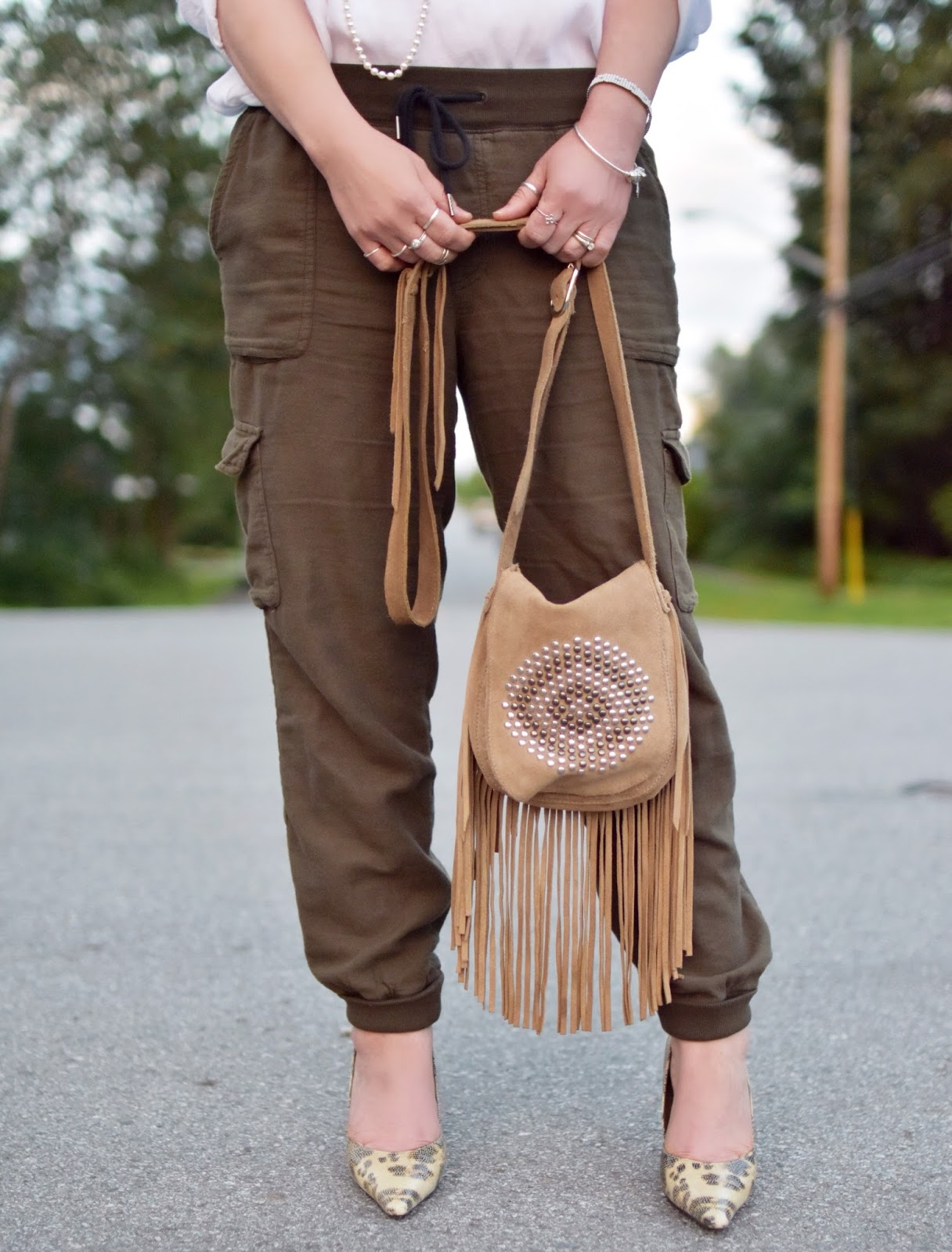 slouchy cargo pants, fringy cross-body bag, reptile pumps