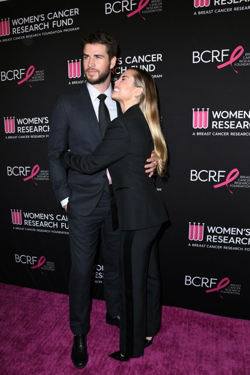 Miley Cyrus suits up and snuggles husband Liam Hemsworth at Beverly Hills breast cancer benefit