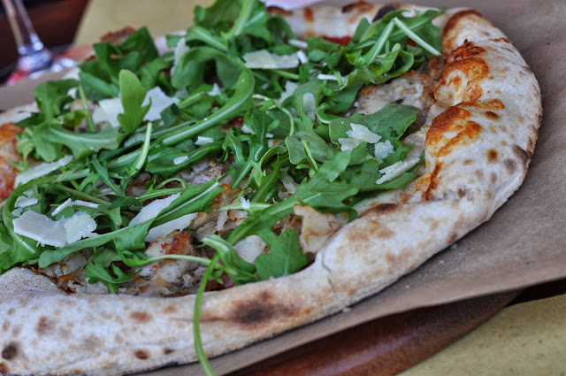 Porchetta, Rucola, and Pecorino Pizza at Ca' Momi at Oxbow Public Market in Napa, CA | Taste As You Go