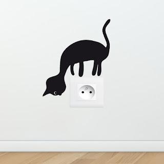 Strickers chat pour prises électriques