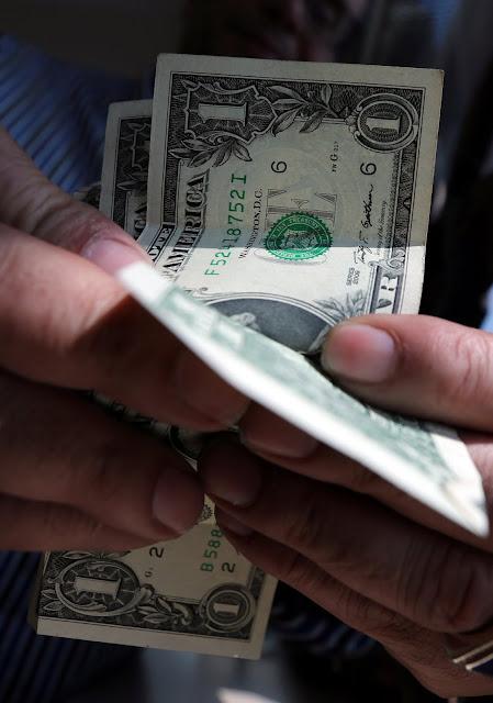 سعر الدولار اليوم الثلاثاء 2017-12-12 واستمرار استقرار العملة الأمريكية