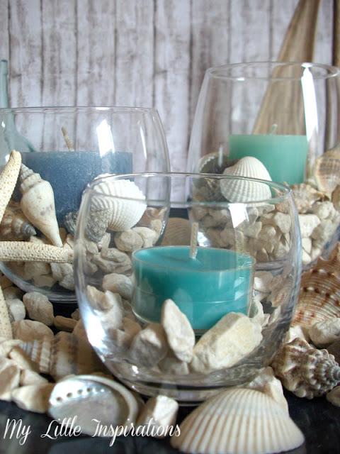 Centrotavola Coastal con conchiglie e candele