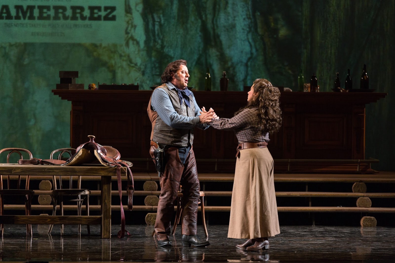 IN PERFORMANCE: Tenor MARCELLO GIORDANI as Johnson (left) and soprano KRISTIN SAMPSON as Minnie (right) in Opera Carolina's production of Giacomo Puccini's LA FANCIULLA DEL WEST, April 2017 [Photo by Mitchell Kearney, © by Opera Carolina]