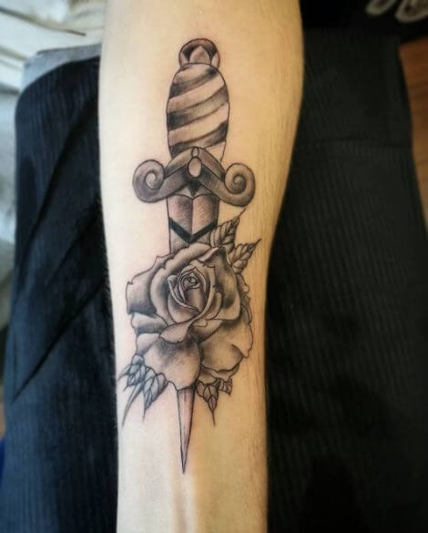 6688e1cdf I have particularly liked this black and grey representation of dagger rose  tattoo which simply implies life should be taken seriously.
